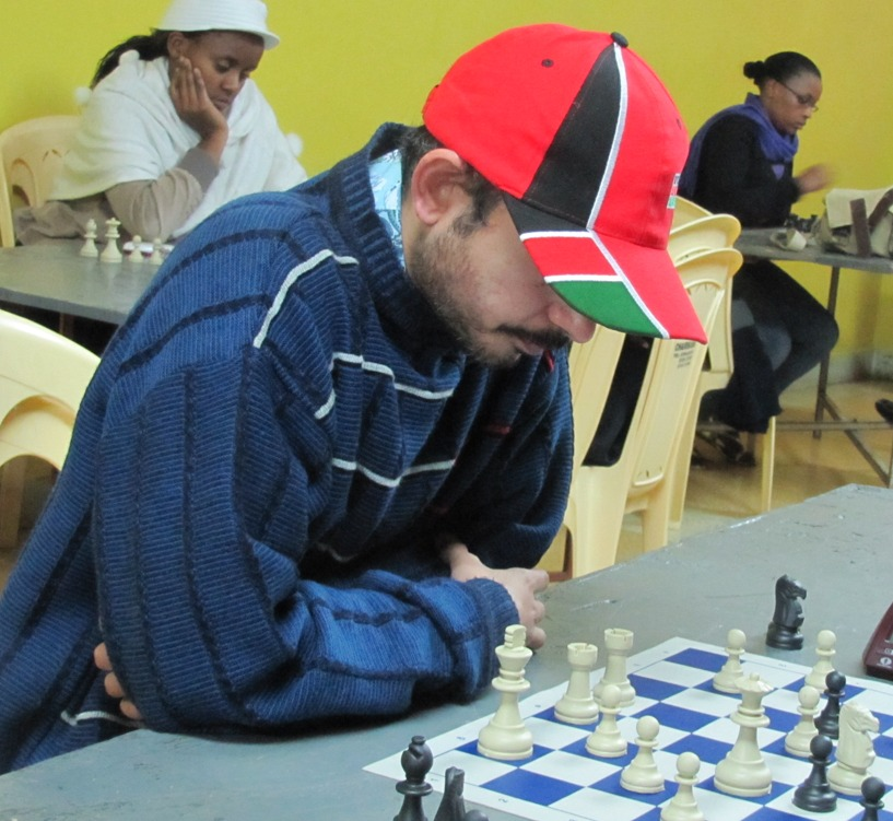 """Mehul Gohil popularly known as """"Gorilla"""" feeling very patriotic and sporting his new Kenya cap in the 2011 All African Games chess qualifiers."""