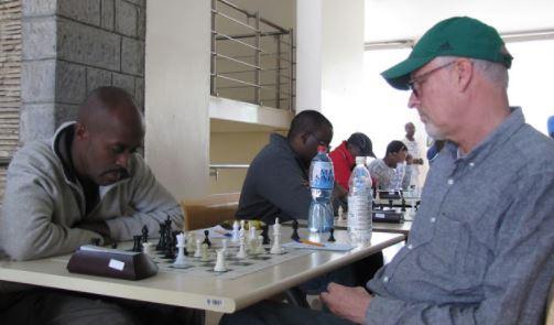 Wachira Wachania v Peter Gilruth in green cap.