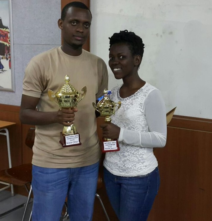Proud winners Niyibizi Alain Patience & Shimwa Faustine pose with their trophies