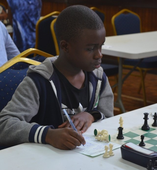 Timothy Mwabu - carrying Kenya's hopes for a medal during the 2018 African Youth Chess Championship.