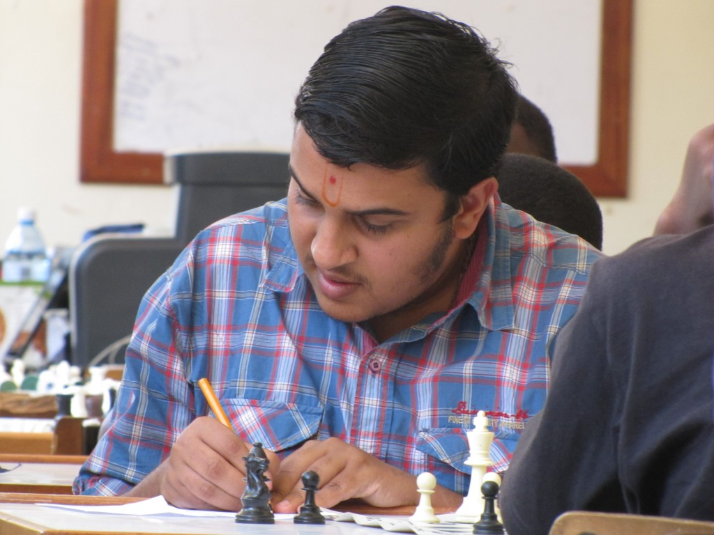 Sachin Gopal Mepani of Strathmore University carefully records his move.