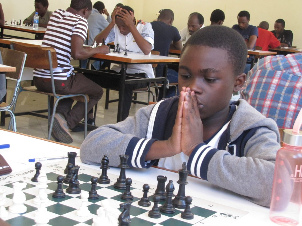 12 year old Timothy Mwabu of Makini School prays before making his move!