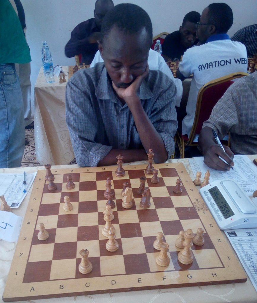 Veteran player Bob Bibasa in action. Note the fine and expensive wooden chess set.