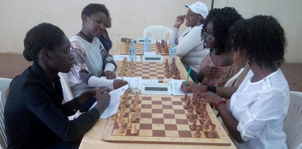 Ladies battling for top honours. WFM Christine Namaganda (middle left ), WFM Angolikin Goretti ((first left), & Shakira Ampaire (third on the left).