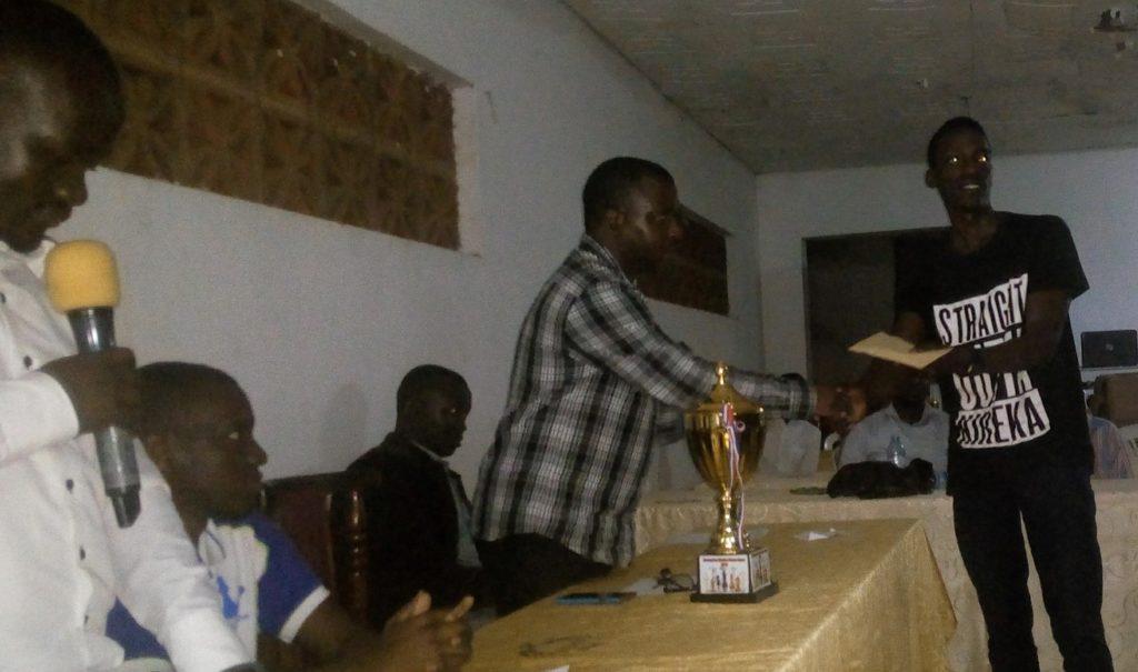 FM Haruna Nsubuga receives his prize.