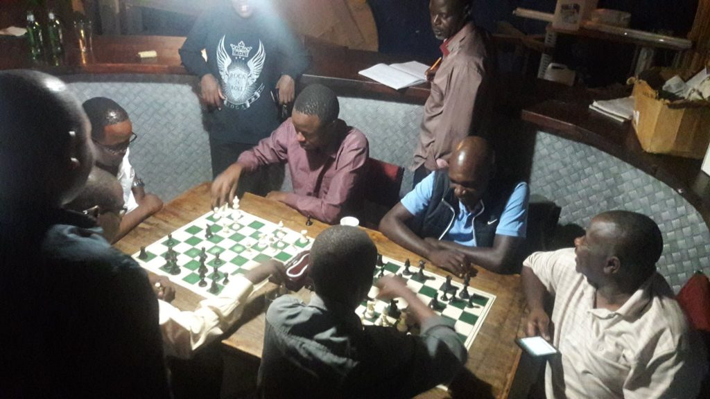 IM Rodwell Makoto (in blue shirt with sleeveless dark blue jacket) tries out his hand at Blitz at the famous Kenya Motor Sports Club in South C.