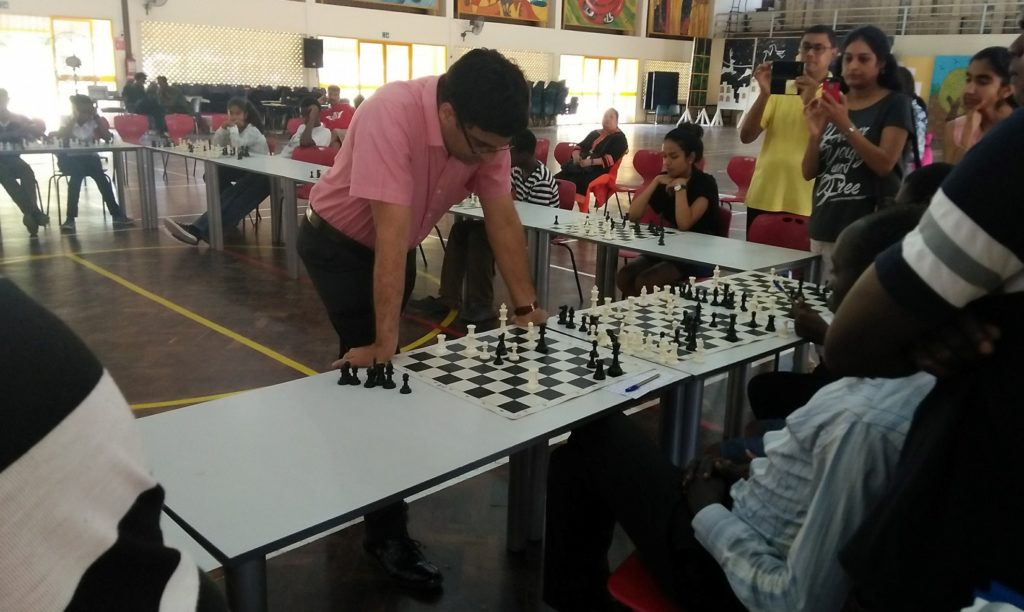GM Viswanathan Anand ponders his move in a game that he was held to a draw by James Panchol. Photo credit Paras Gudka.