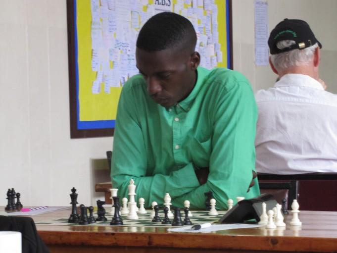 FM Haruna Nsubuga in action during the 6th Capablanca Chess Tournament held in February 2016 in Nairobi, Kenya.