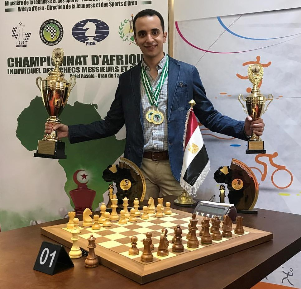 A proud and happy GM Bassem Amin poses with this top prizes in the Classical and Rapid section of the 2017 African Individual Chess Championship. Photo credit unknown.
