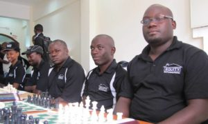 Other Rwabushenyi Memorial Champions.  IM Elijah Emojong (4th from left) and IM Arthur Ssegwanyi.