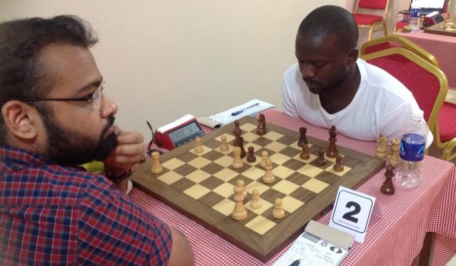 GM Abhijeet Gupta of India (left) takes on IM Richmond Phiri of Zambia during the Starting list of the Henry Chilufya Memorial Chess Tournament. Photo credit Chanda Boyd Nsakanya.