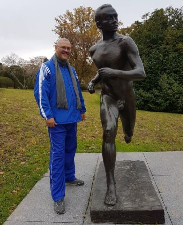 Dr Bouah with statue of Emil Zatopek in Lausane, Switzerland.