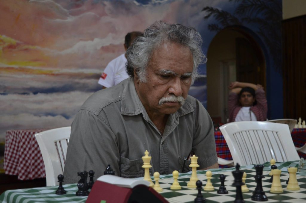 Nazir Lone in action and who represented Kenya in the Against Chess Olympiad held in 1976 in Tripoli. The 22nd Olympiad was awarded to Haifa, Israel and a number of countries boycotted that Olympiad. Libya then organised the Against Chess Olympiad which ran from 24th October to 15th November 1976.