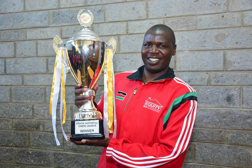 Happy Captain Benard Wanjala of Equity Bank poses with the trophy.