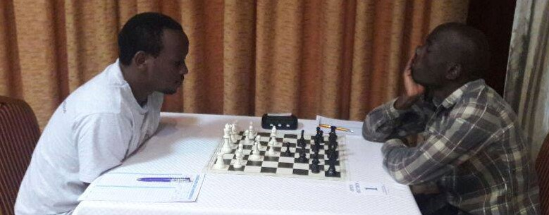 Kenyan Githinji Hinga (left) takes on IM Elijah Emojong of Uganda in a game that ended in a draw.