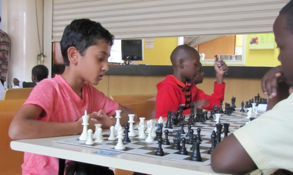 Aman Bhari of Nairobi Chess Club youth team ponders on his move.
