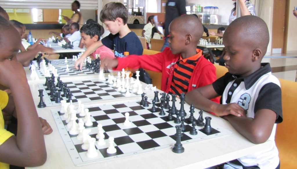 "Nairobi Chess Club's youth team named ""Karjakin Kids"". From left Aman Bhari, Andrei Negru, Leone Wachira Wachania, and Matheri Macharia."