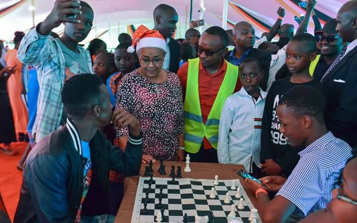 First Lady Margaret Kenyatta chats with some of the players.