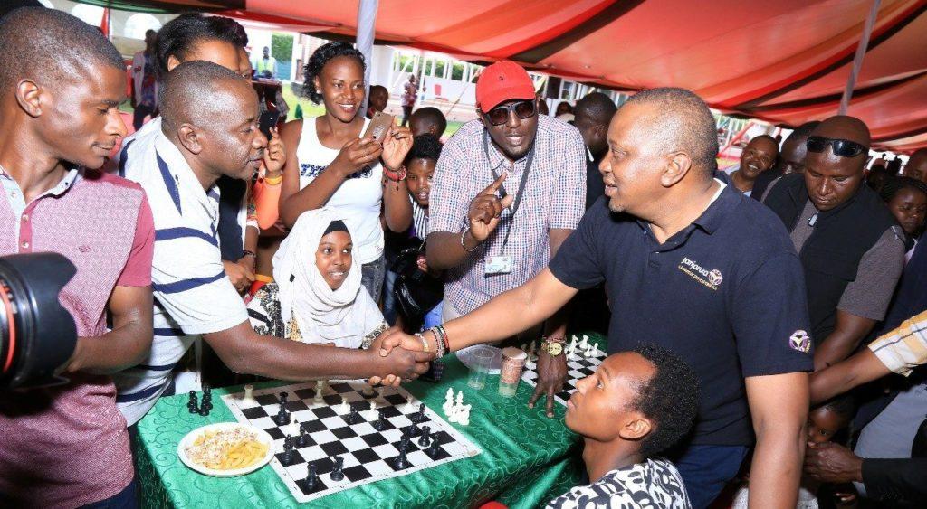 "The ""handshake"" that could propel Kenyan chess!  HE President Uhuru Kenyatta wishes CEO of Terrian Chess Academy Brian Kidula.  Photo credit Presidential Press Unit."