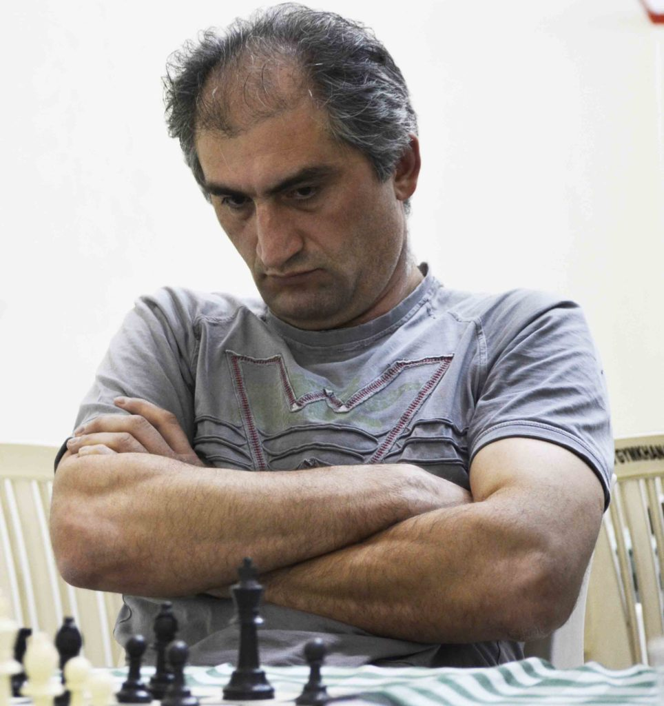 Musfig Habilov in a pensive mood in his game against Peter Gilruth.
