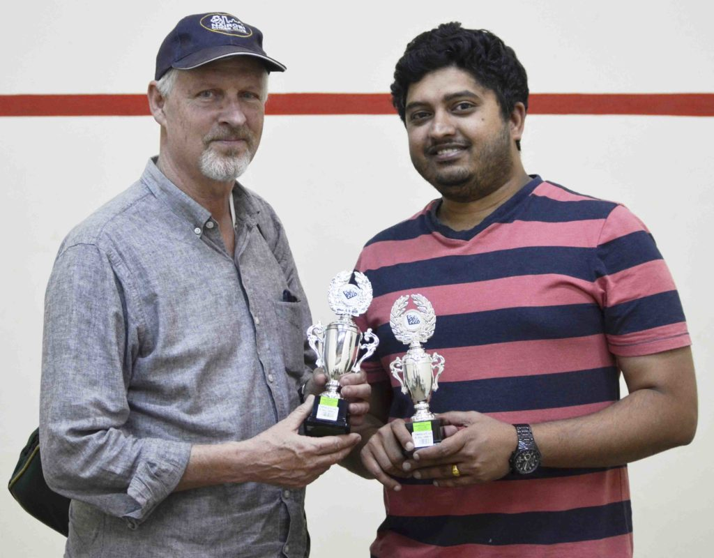 Winner Peter Gilruth (left) and Vasanth Ramesh - Runners Up pose with their trophies during the Jamhuri Cup.