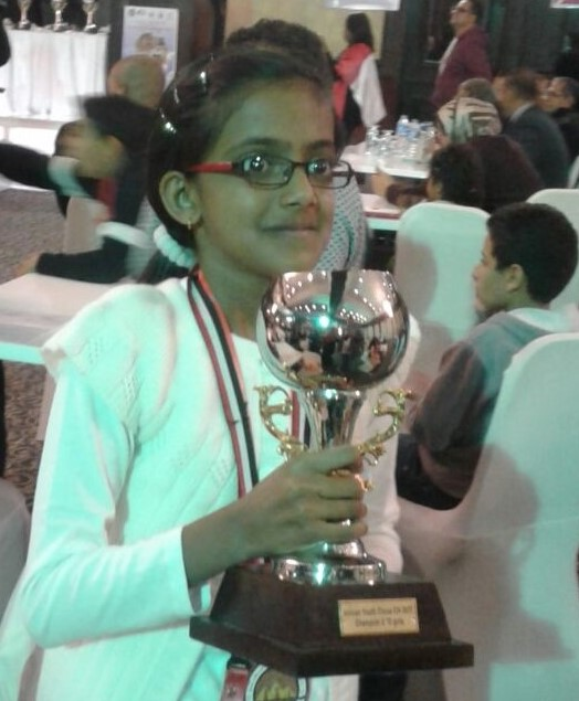 Fathima Mohamed posing with her glittering trophy.
