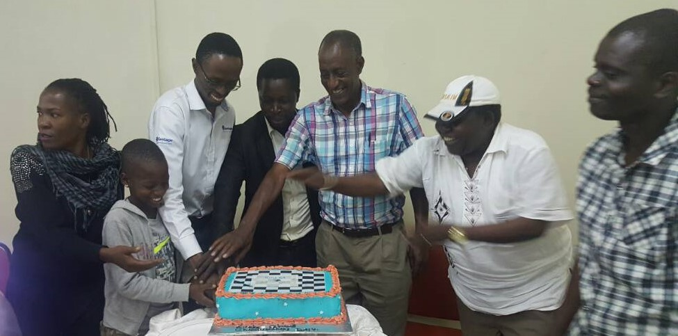 Cake cutting for Kireka Club. From left to right Nsubuga Rita an Olympiad player from 2014 (she finished 4th) the little girl is 10 years old (the youngest player in the open rated category) Harold Wanyama(winner of the event) Eng. Mwaka Emmanuel (current UCF President) Eng. Jasmine Joseph Kaamu (winner of best seniors prize and former president of UCF) Mr Chirya ,Patron of Arua Chess Club. Wesonga Micheal veteran chess player and first organizer of Kireka Open that was held in 2002.