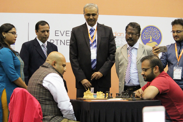 GM Abhijeet Gupta (right), Praful Zaveri (standing in the middle) and Sagar Shah (extreme right) of Chess Base India.