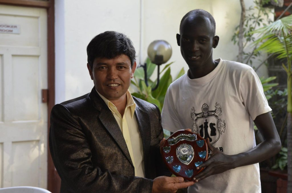 Meerabbas Afzali (left) presents James Panchol with the Winner's Shield.