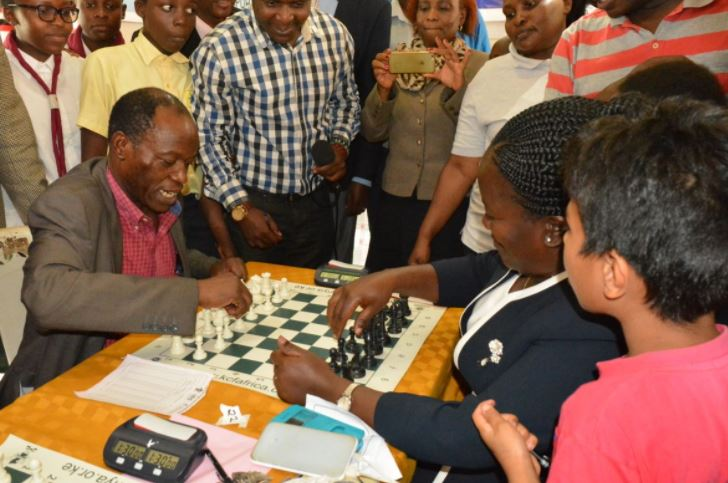Deputy Governor of Vihiga County, H.E Dr. Partrick Saisi (left) playing a game against Ms Violet Oyungu the Principal of Kaimosi Girls.