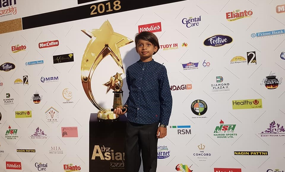 Proud winner Drish Shah poses with his Young Achiever of the Year Award.