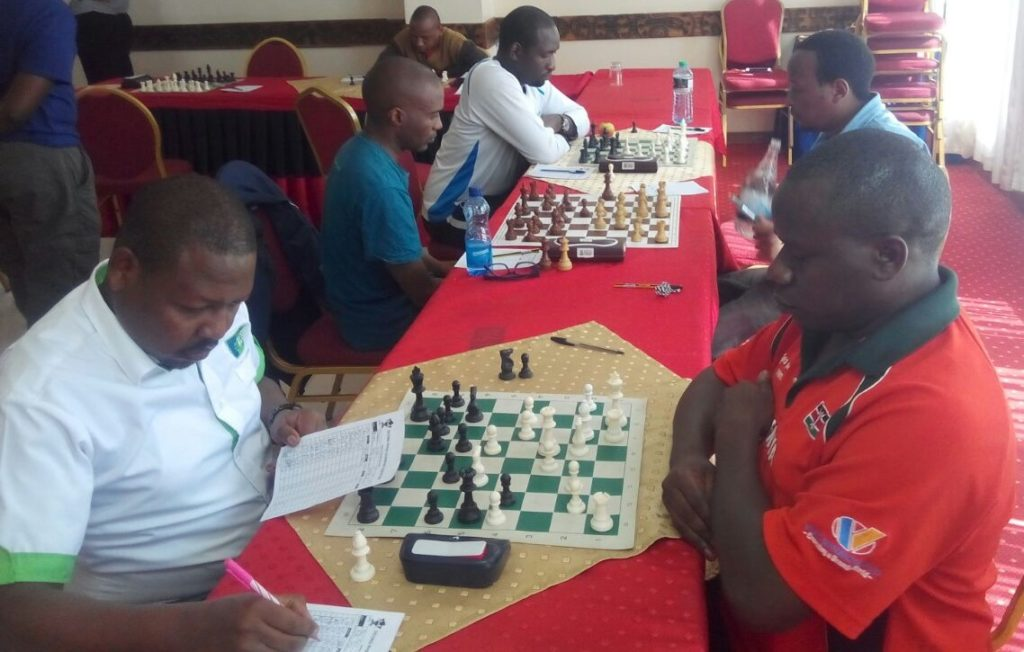 Ricky Sang (left) with the black pieces against FM Steve Ouma.