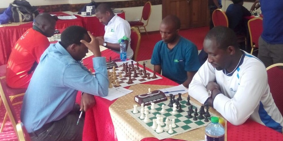 Intense action. From left - FM Steve Ouma (in red jacket), Githinji Hinga (blue shirt), Victor Ng'ani (white shirt) and Philip Singe.