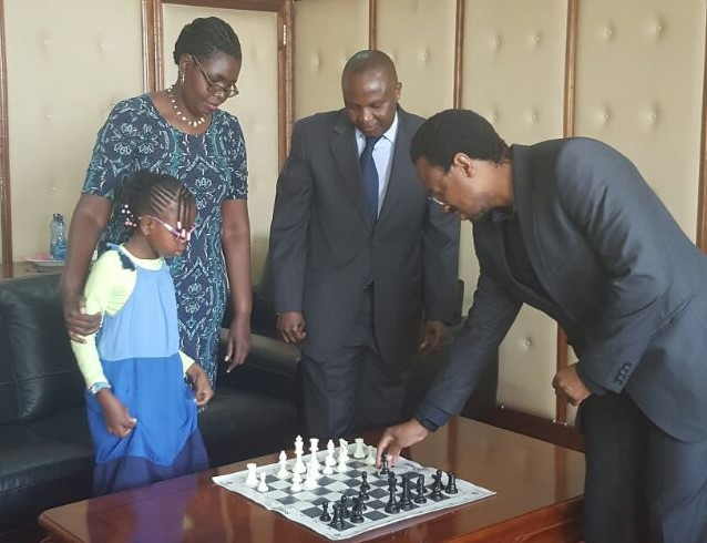 Directors of Lighthouse Chess Club meeting with the Education PS.   Standing from left to right Yvonne, Judith Kiragu, Professor Japheth Ntiba and Dr Mwashe. Dr Mwashe explains the rules of the game.