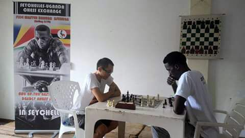 Photo from the St Louis Open. FM Haruna Nsubuga (right) in action.