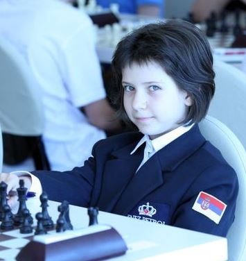 Charming player proudly wearing the Russian flag. Photo credit Eteri Kublashvili and Vladmir Barsky.