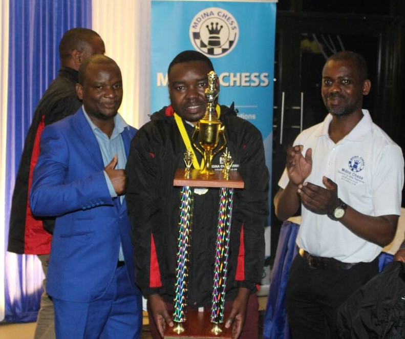 Proud winner with the trophy. From left Mr Kamwendo, 2018 Mdina Malawi Open Joseph Mwale and Mr Jeka Chipofya. Photo credit Makhosi Nyirenda
