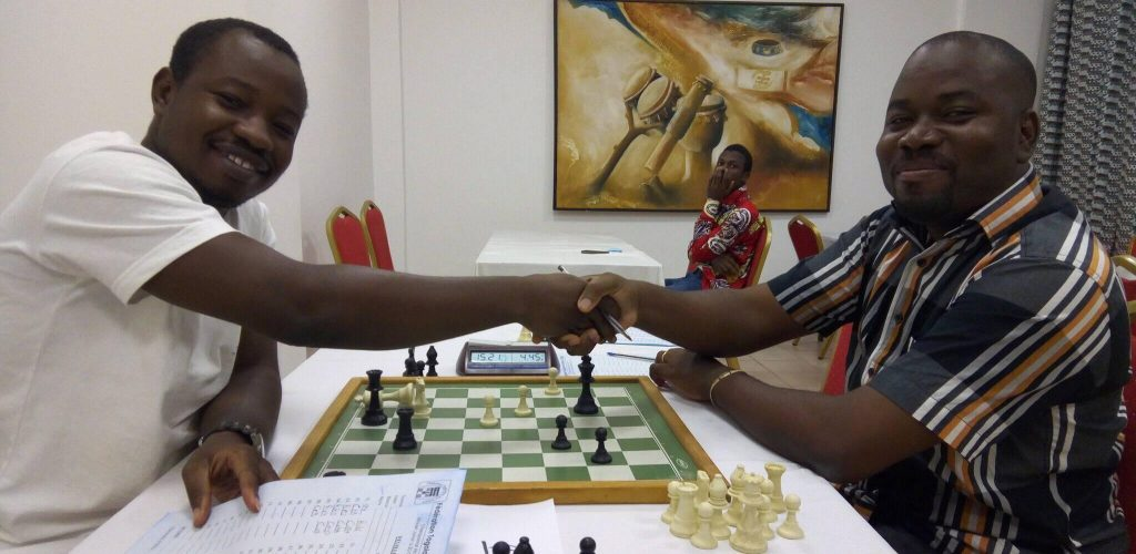 Who will be the Champion of Togo? Ajavon Ayayi (left) shakes his opponent's hand Noel Fumey.