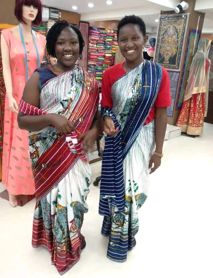 Our charming ladies from East Africa WCM Joyce Nyaruai & WFM Christine Namagana try out some Indian outfits!