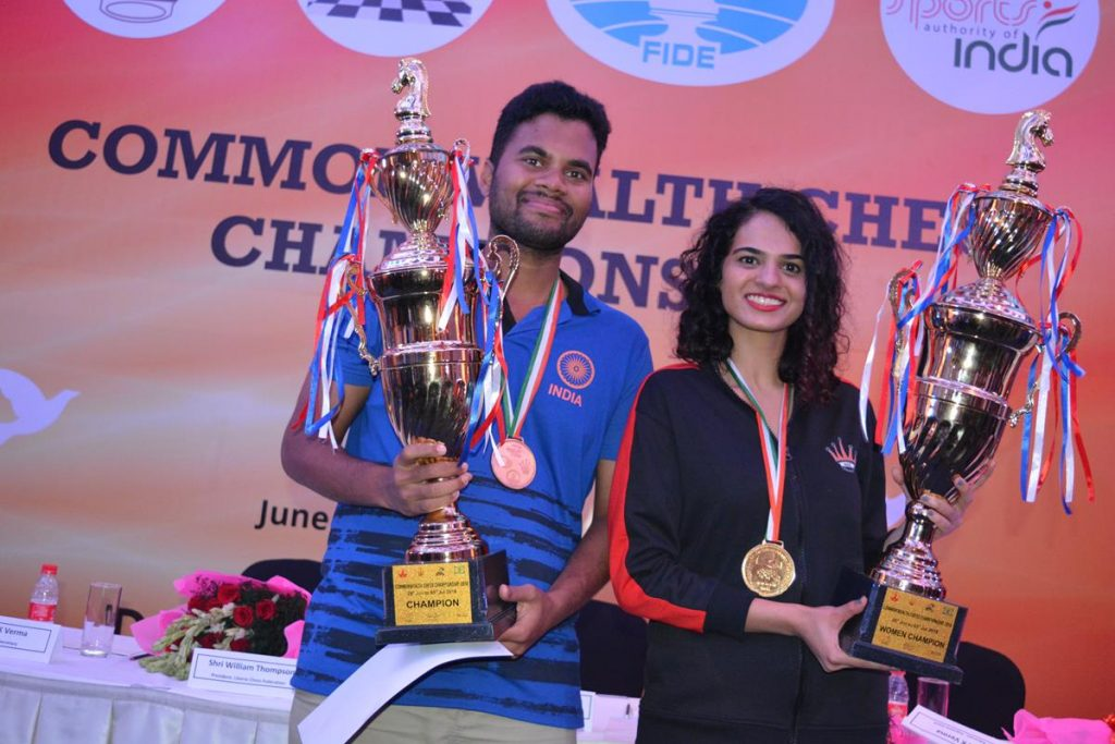 Winners IM P Karthikeyan and IM Tania Sachdev pose with their massive trophies. Photo credit Delhi Chess Association.