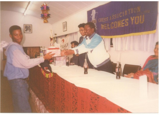 1993 African Junior Chess Champion Aderito Pedro of Angola receives his prize from the late Tom Sagwe Chairman Kenya Chess Association