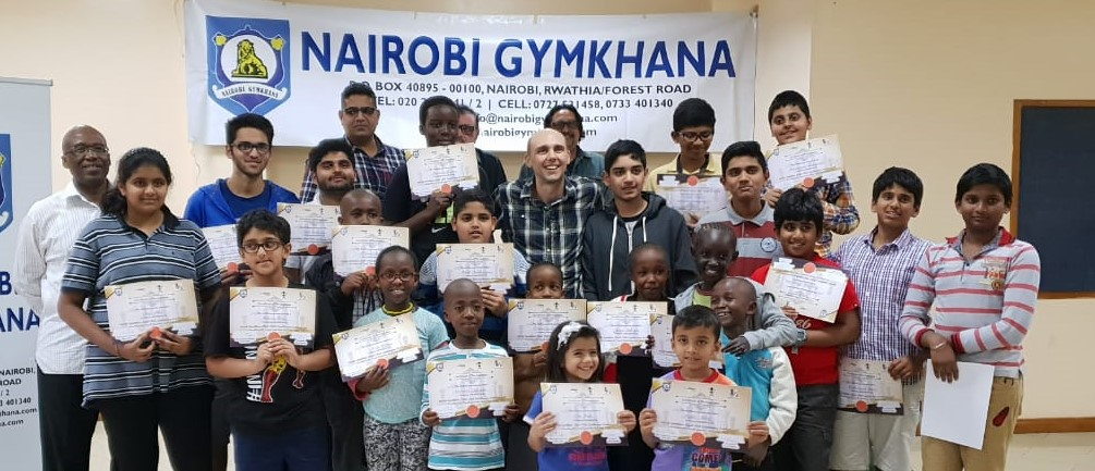 Participants pose with GM David Smerdon. Larry Kagambi who is the Nairobi Gymkhana Club chess coordinator is standing at the extreme left)