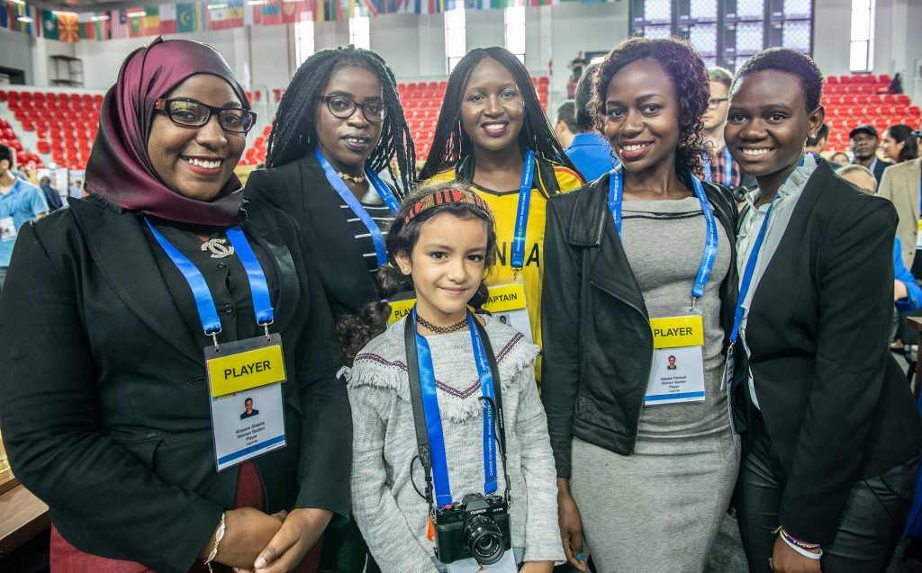 Team Uganda meets the cutest paparazzi. Standing from left - Shakira Ampaire, Phiona Mutesi (from Queen of Katwe), Christine Namaganda, Peninah Nakabo, Gloria Nansubuga. Nahui Llada poses with the team. Photo by David Llada.