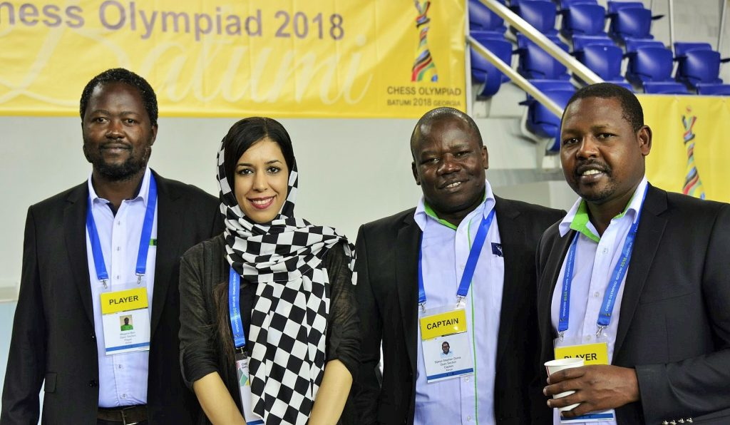 Team Kenya posing before the start of round 5. From left CM Ben Magana, IA Shohreh Bayat (Secretary General of Iranian Chess Federation), FM Steve Ouma & Ricky Sang.