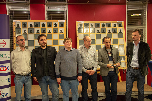 Prize giving ceremony with GM Bassem Amin (2nd from left) and tournament director (extreme left) Loek van Wely.Photo credit https://www.hoogeveenchess.nl/en.