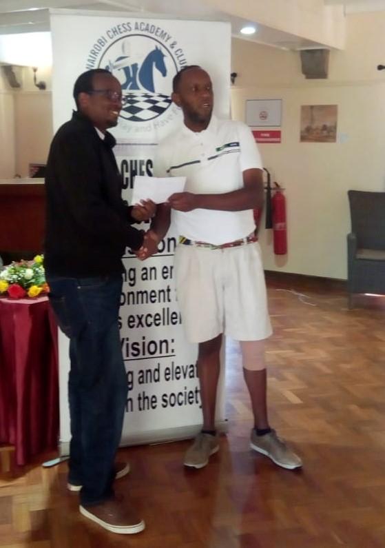 Githinji Hinga (left) receiving his prize.