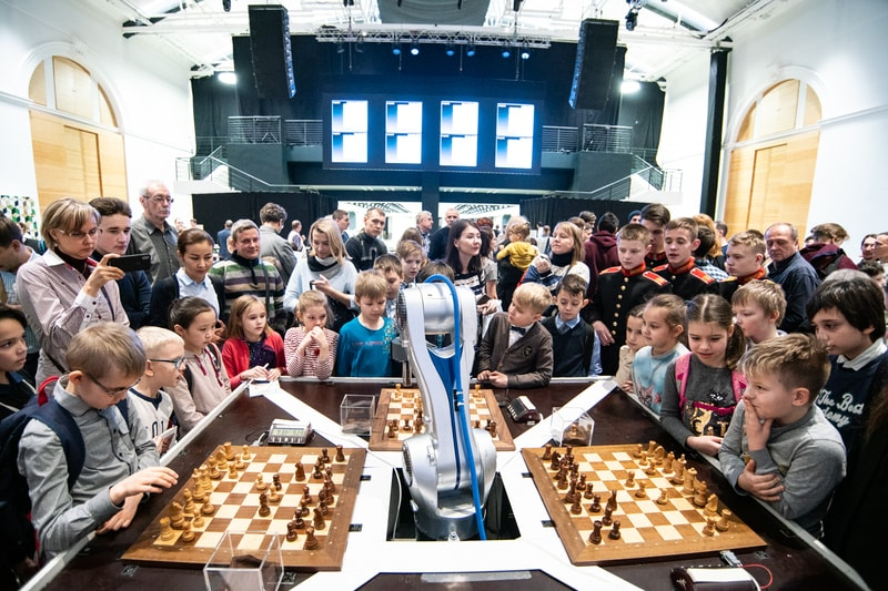 Chess playing robot taking on 3 opponents at the same time. Photo credit Maria Emelianova of www.chess.com