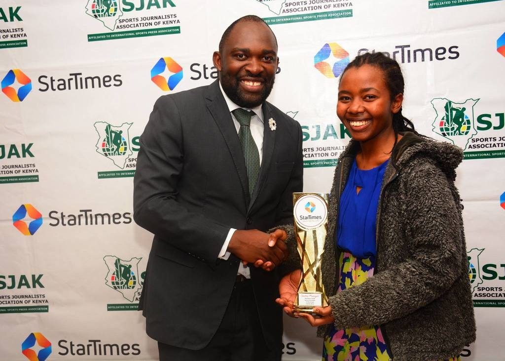 Star Times Director of Marketing and PR, Mr. Japheth Akhulia presents Sasha Mongeli with her prize.  Photo credit Star Times.