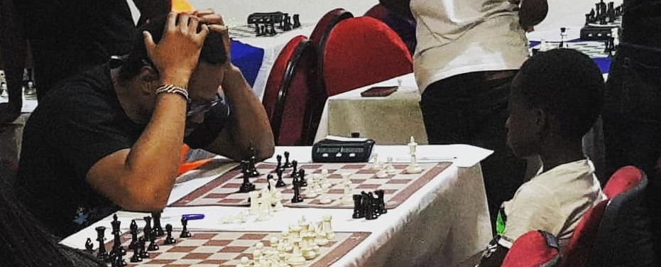 Dr Philip Mwashe holds in head while fighting for a draw against Tandeka Shiloh.