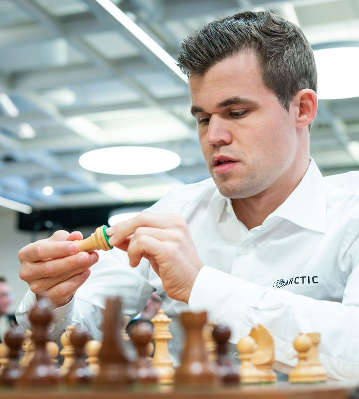 World Champion Magnus Carlsen inspects a Rook. Photo credit Lennart Ootes.